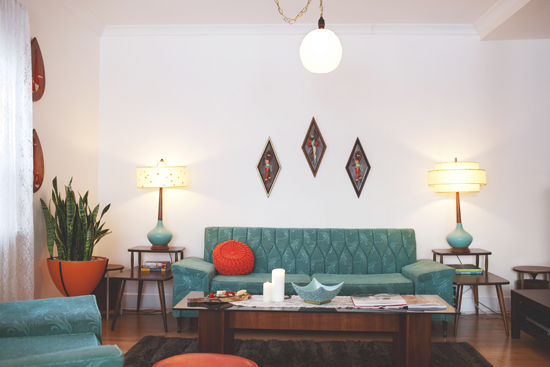 The Turquoise Sofa In The Living Room ...