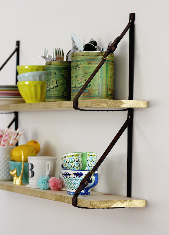 DIY wooden shelf with belt straps