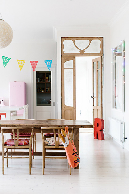 Colorful dining room (love the big industrial letter)