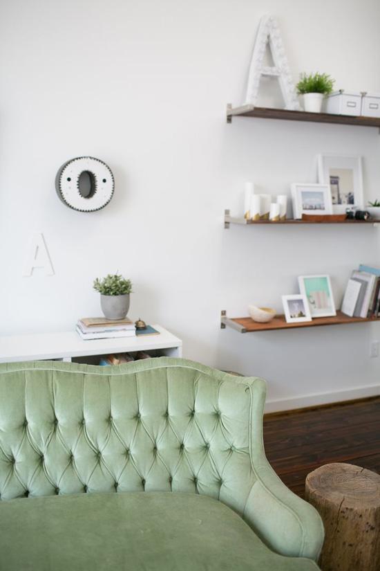 Tufted green sofa