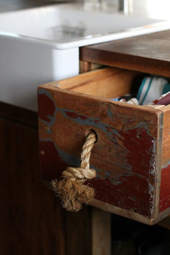 Rope makes a cute and inexpensive drawer pull