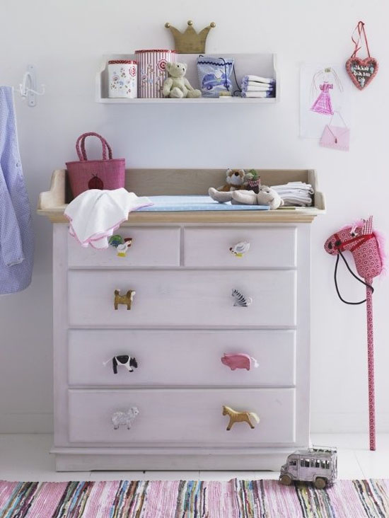 Wooden animal puzzle pieces as drawer handles for a kid's dresser