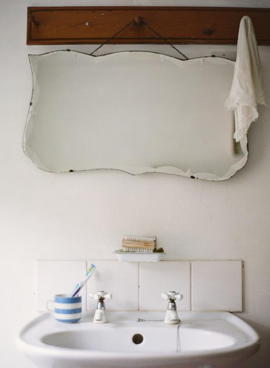 Hang a vintage mirror in the bathroom