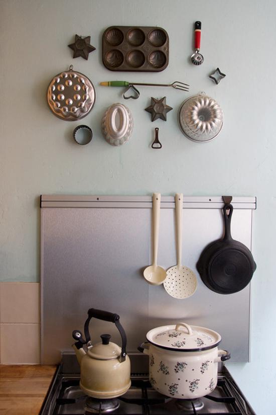 Vintage utensils mounted on the kitchen wall