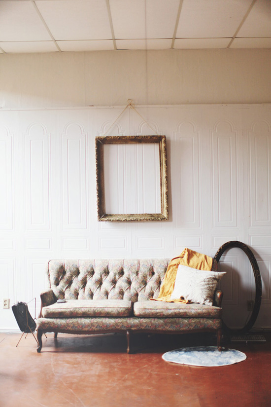 Tufted sofa and empty frames