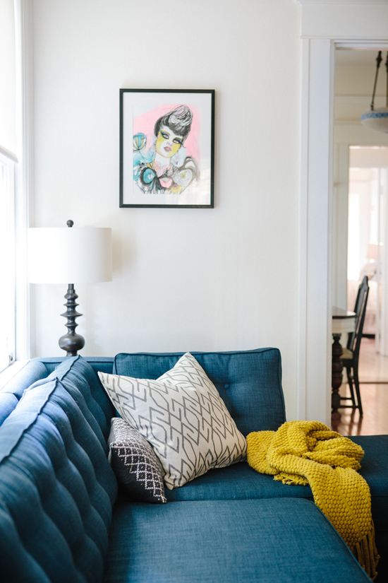 Blue sofa with a mustard throw