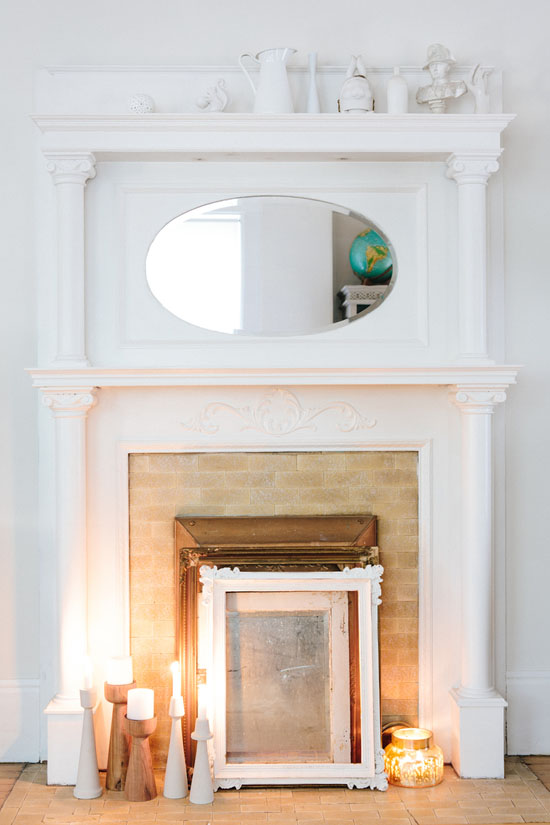Mantel with a collection of white objects
