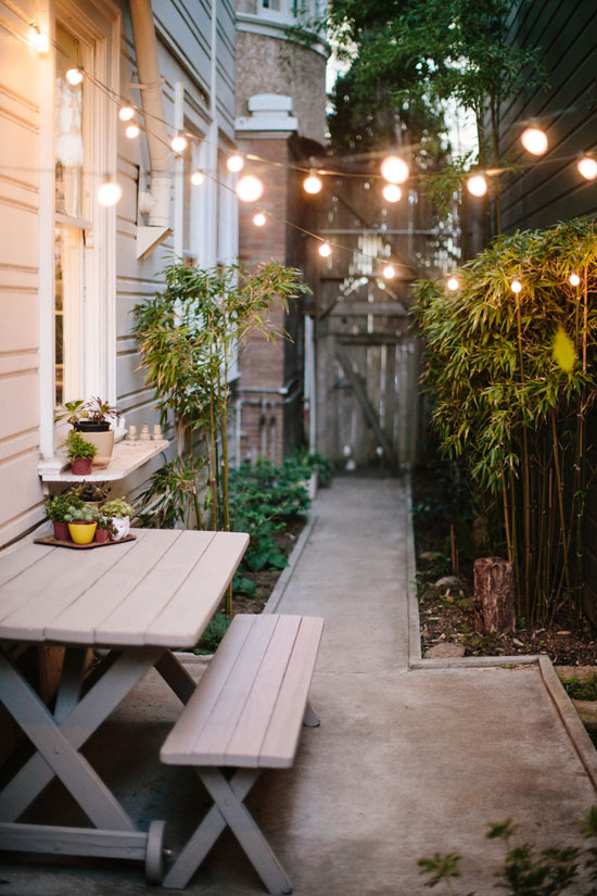 Outdoor space with globe lights hung up
