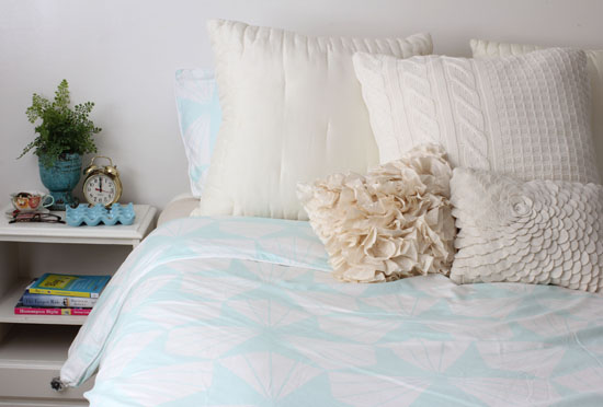 Bed with mint green duvet