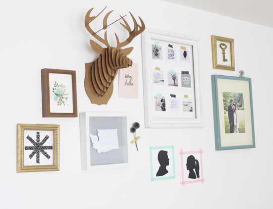 gallery wall with cardboard deer head and diy art