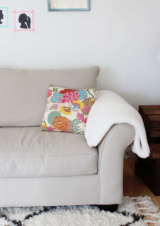 Colorful pillow and sheepskin throw