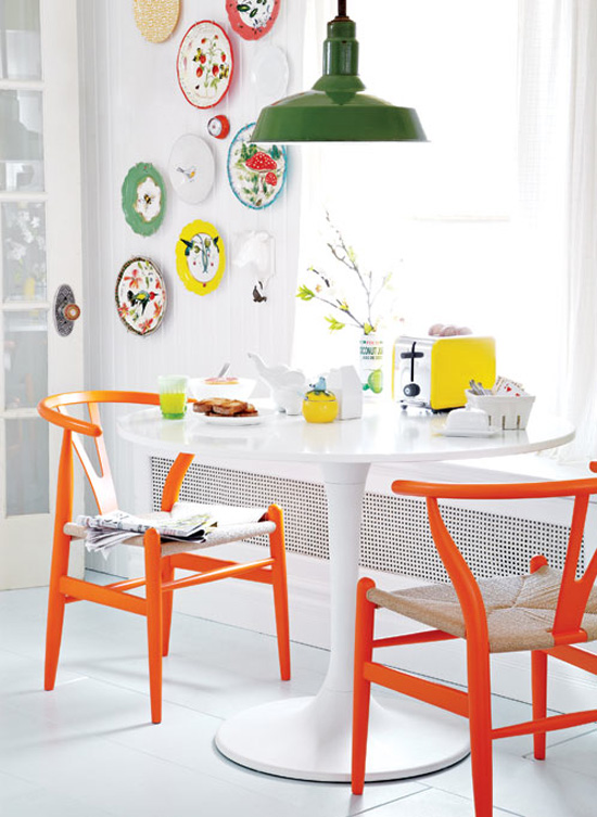 Orange wishbone chairs