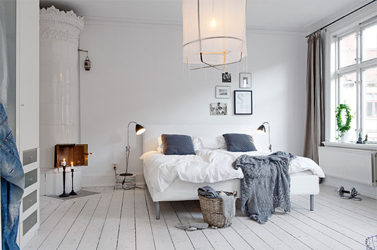 Gorgeous bedroom with freestanding fireplace and breezy cotton lamp