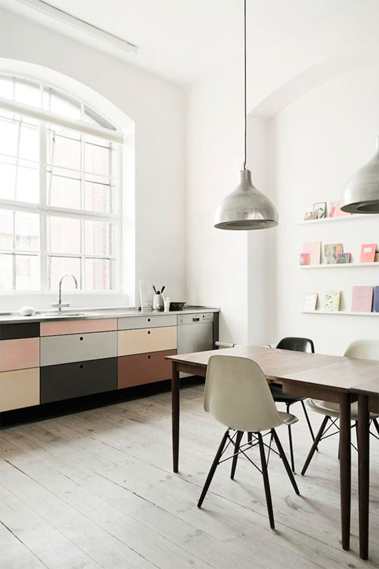 Pastel kitchen with cutout cabinet pulls