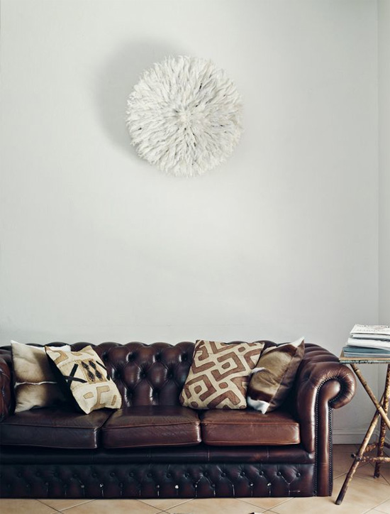 Chesterfield sofa and juju hat on the wall