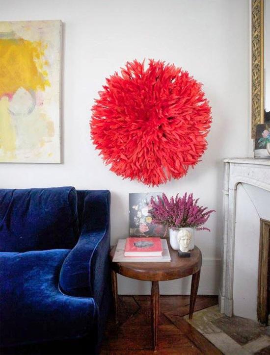 Pink juju hat, blue velvet sofa
