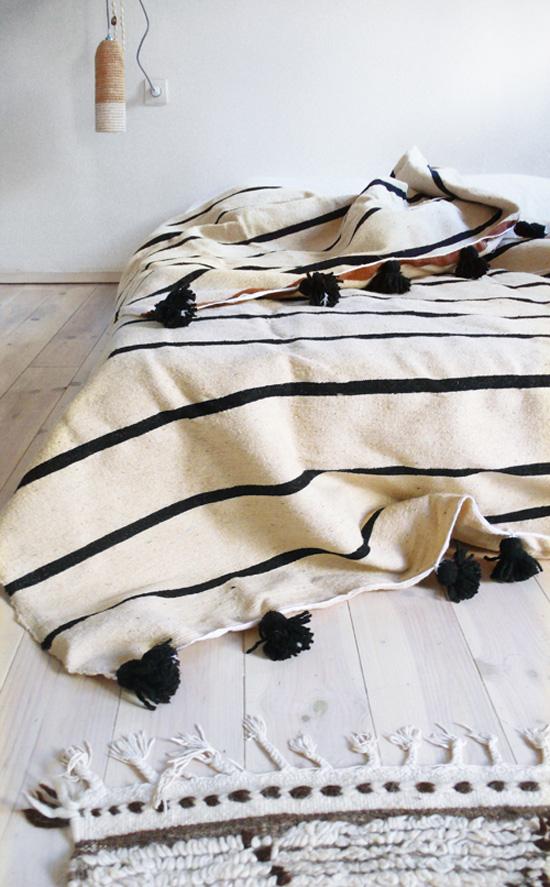 Striped pom pom blanket