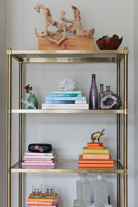 Try stacking books horizontally and separating them by color, instead of stacking them vertically