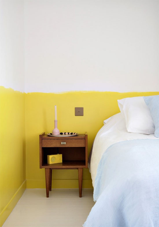 Bedside table and half-painted wall