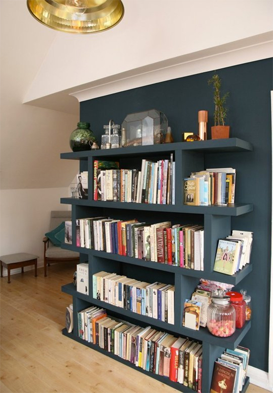 Bookshelf painted to match the wall