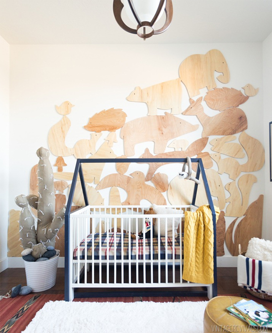 Cool nursery with DIY woodland animals wall and a cloth cactus