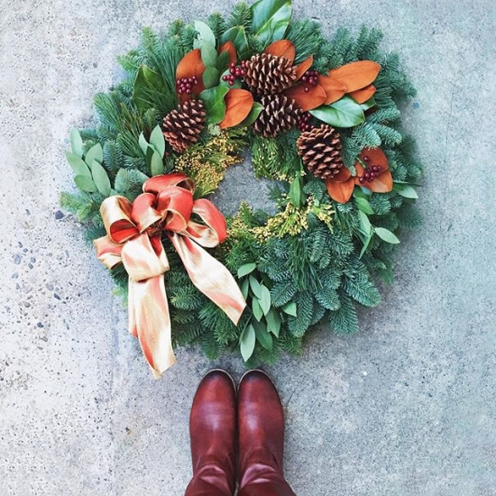 Wreath with magnolia leaves, berries, and pinecones