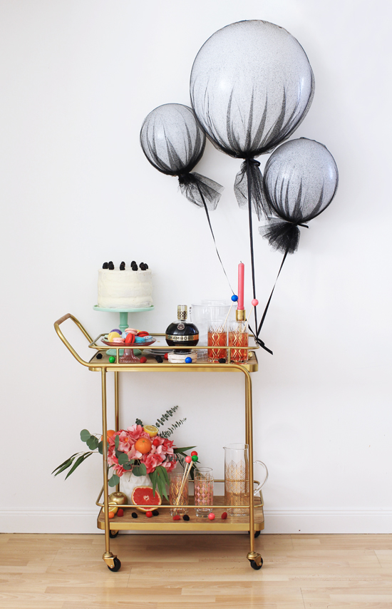Bar cart with tulle-covered balloons