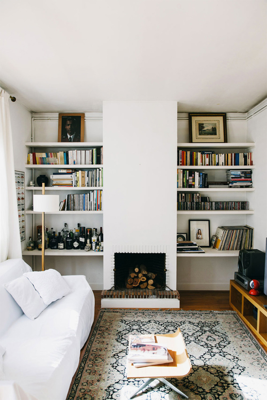 Fireplace flanked by bookshelves