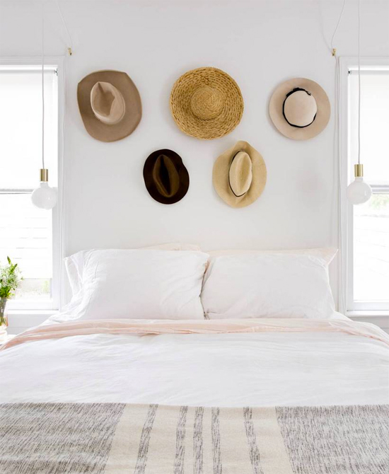 Hang hats above your bed as art