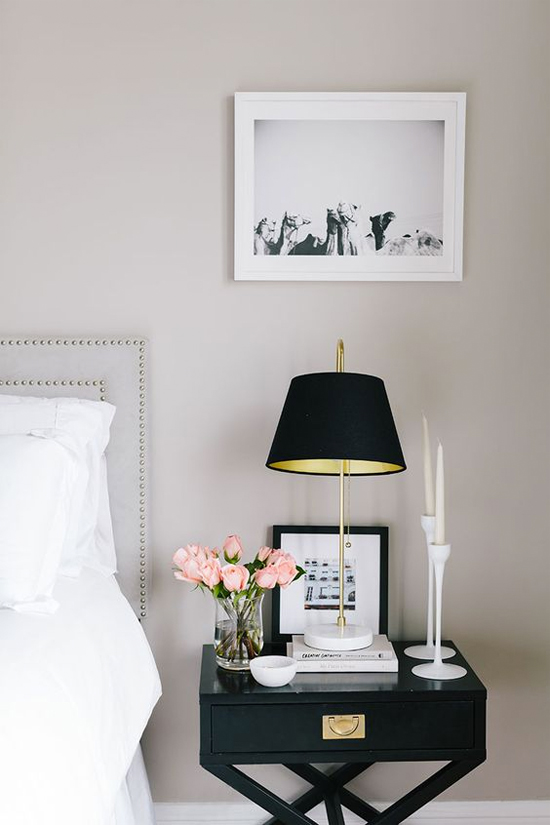 black bedside table & wall sconce