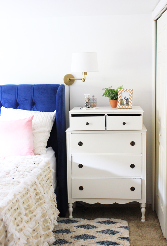Use dresser as a nightstand to save space in a small bedroom
