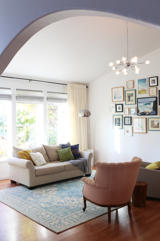 Our living room window treatments & gallery wall