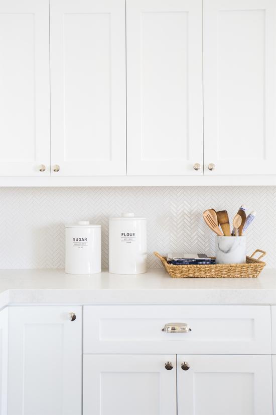 White Kitchen Cabinets And Herringbone Backsplash