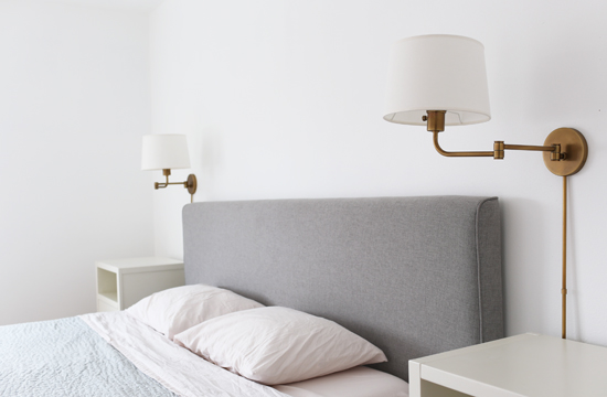 Sconces on either side of bed