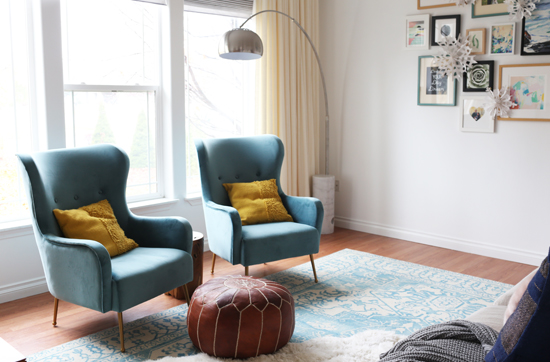 Blue velvet armchairs and modern floor lamp